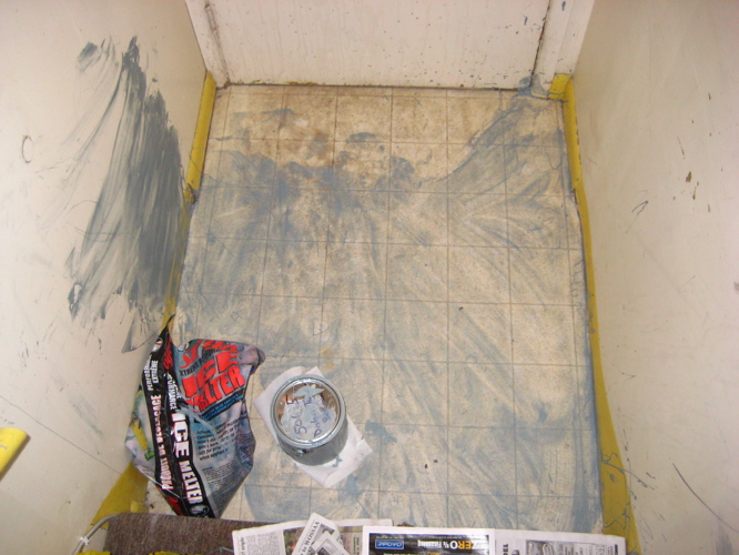 A wiped-up puddle of blue-grey paint