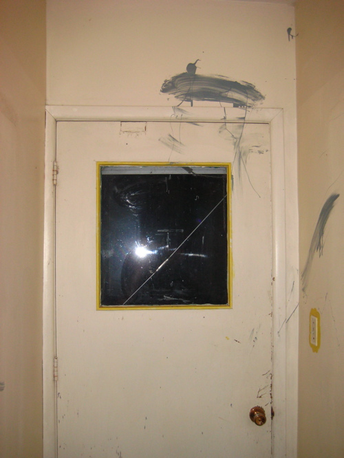 Paint smeared above a door