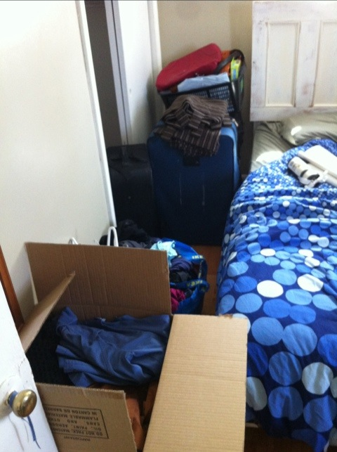 My closet, emptied into suitcases