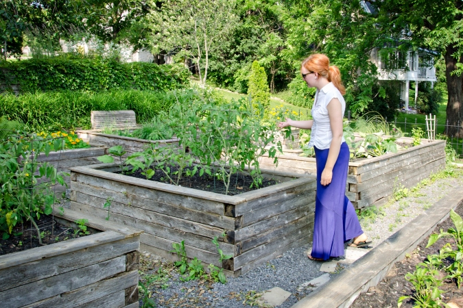 Sarah in Almonte Riverside Boutique Inn garden - by Amy Eaton